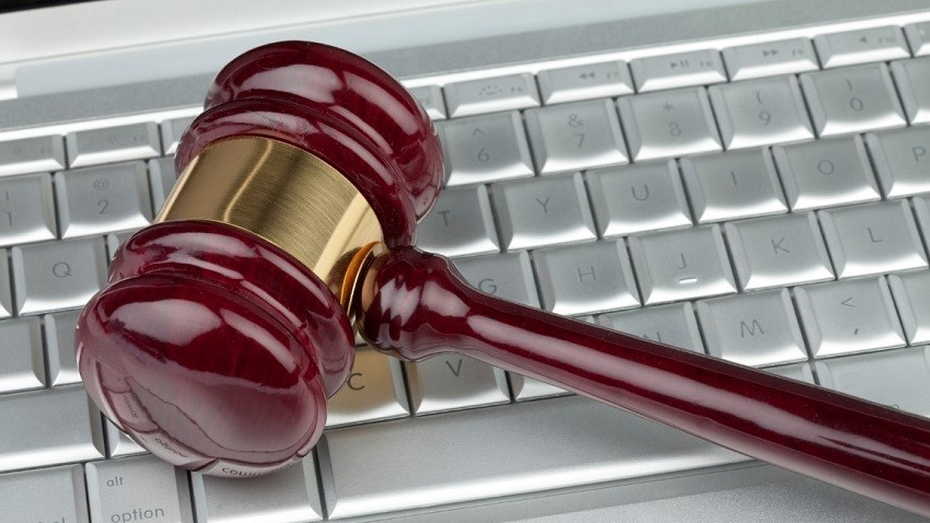 gavel on top of laptop