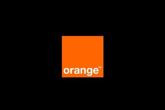 Pomarańczowe logo Orange na czarnym tle